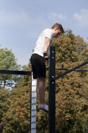 WARSAW, POLAND - AUGUST 20: Unidentified athlete performs during Street Workout Poland Championships on August 20, 2016 in Warsaw.
