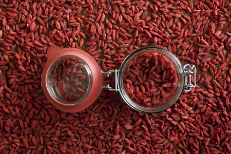 superfruit: Goji berries on the wooden table Stock Photo
