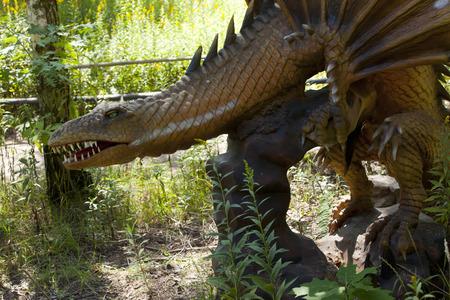 MOÅšCISKA, POLAND - August 8: Dragon model in amusement part Farma iluzji, Poland on August 8th 2016 Publikacyjne