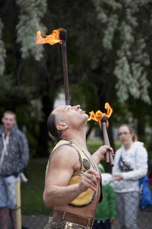 WARSAW, POLAND, June 1: Juggler with blazing torches during a performance on Childrens Day party June 1, 2017 in Warsaw, Poland.