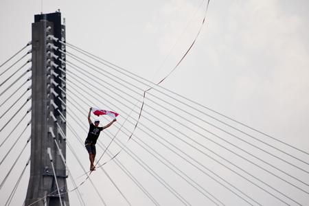 Warsaw, Poland- September 9, 2018: equilibrist walking on the rope above the Vistula river during Vistula Fest