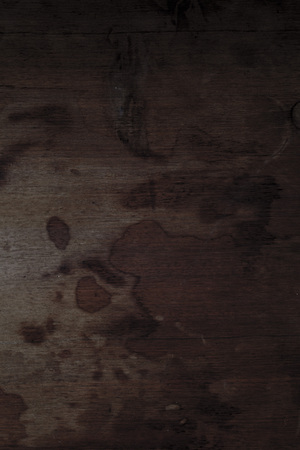 Old wooden board with stains for background