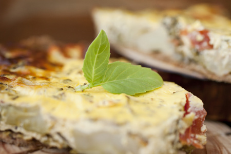 Piece of Vegetable pie with broccoli Stock Photo