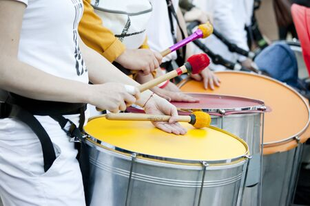 Warsaw, May 1, 2019,- Musicians playing on drums during a street parade on May 1, 2019 in Warsaw, Poland