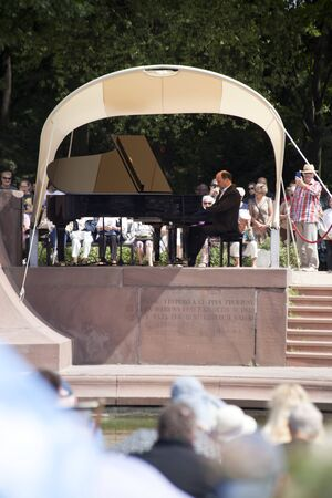 Warsaw, Poland. 4 August 2019,- Outdoor open recital of Chopins music- The oldest Polish recital which takes place in Lazienki Park every Sunday in the summertime in Warsaw, Poland. Editorial