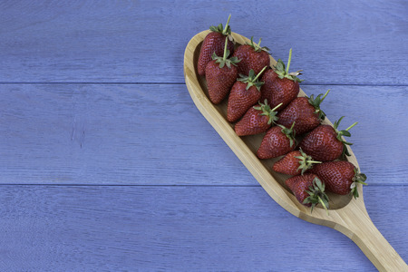 Strawberries on a wooden table Imagens