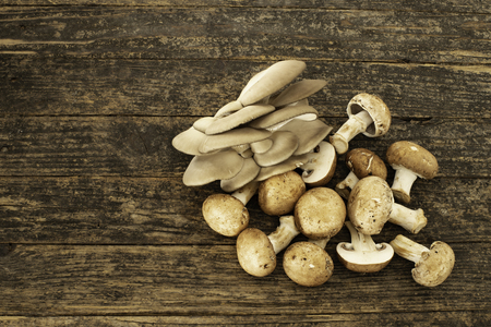 Mushrooms on the rustic wooden table