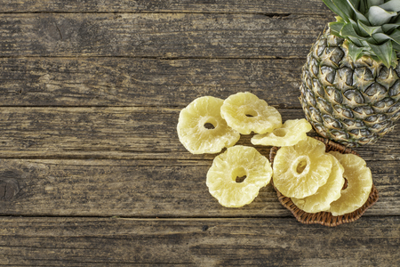 Pineapple on the wooden rustic table