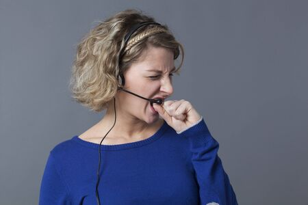 conflicted: furious 20s blonde entrepreneur screaming over the phone