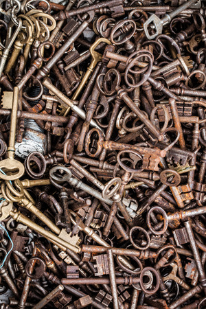 oldie: display of old rusted and brass keys in bulk for collection or decoration sold at flea market or garage sale for antique collection Stock Photo