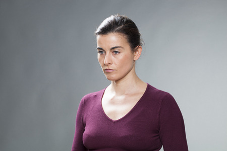 30s: portrait of thinking 30s girl alone with seasonal affective disorder syndrome, studio shot Stock Photo