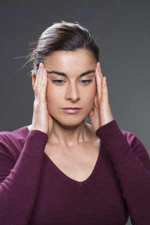 acupressure hands: beautiful 30s woman practising face acupressure  with hands on face and temples for natural eye lifting