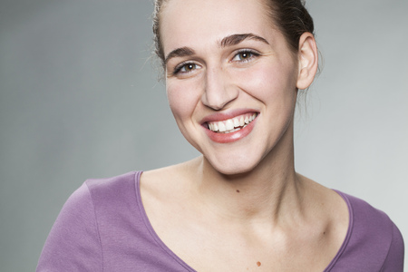 20s: closeup on relaxed smiling 20s girl expressing happiness and beauty