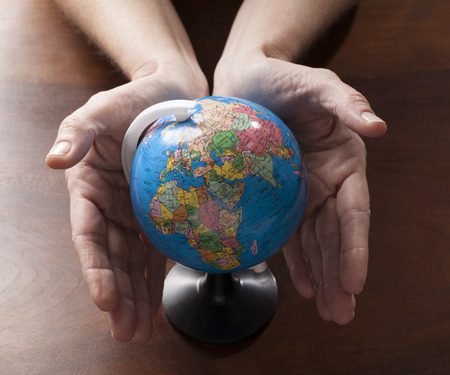 woman's hands caring for the planet focusing on green energy and humanity respect