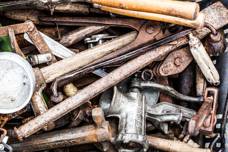 handy man: closeup of display of used rusty utensils and accessories of handy man or DIY man for old tool collection or reuse sold at flea market or garage sale for recycling objects