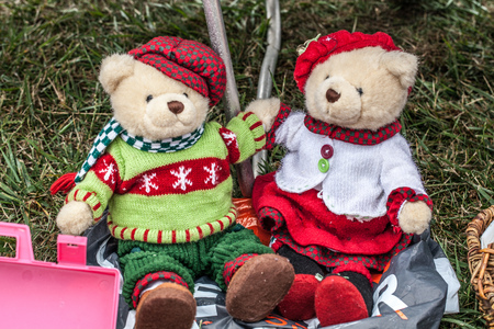second hand: display of a couple of second hand teddy bears dressed up for winter or Christmas time with home-made knitwear sold at garage sale for antique collection