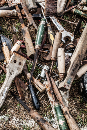 handy man: display of used rusted paint utensils of handy man for collection or reuse sold at flea market or garage sale for recycling objects