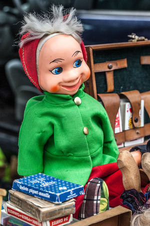 oldie: display of 30s or 40s male doll or puppet with old card games and specialty briefcase sold at flea market for antique collection Stock Photo
