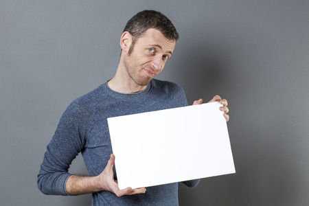 discreet: discreet 40s man suspecting the truth about a claim held on his white board Stock Photo
