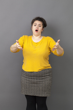 sad lady: complaining overweight 20s woman expressing exasperation and frustration in front of someone