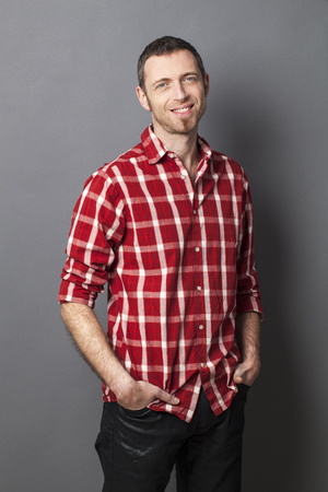 man with a goatee: natural smile - relaxed smiling middle age man wearing casual red checked shirt with beard and goatee for cool attitude,studio shot