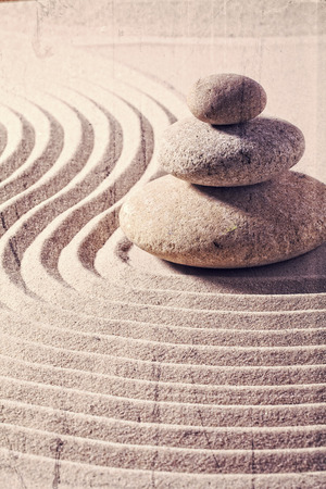 steadiness: zen still life for spa and massage with sand and stones for balance and meditation with textured and contrast effects