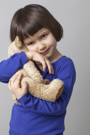 peacefulness: cuddling and hugging for preschool child for serenity and peacefulness Stock Photo