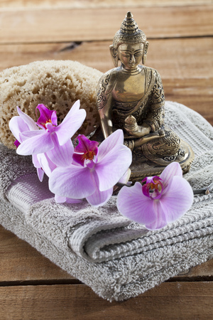 inner beauty: Buddha for spirituality at beauty spa with sponge flower massage and ritual accessories