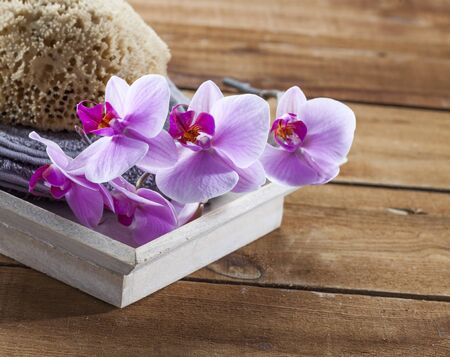 inner beauty: beauty ritual for spa treatment with natural sponge, towel, flowers and massage accessory