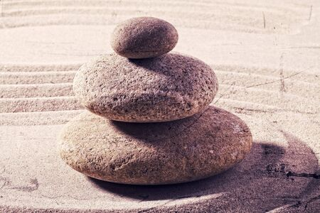 suppleness: zen still life for spa and massage with sand and stones for balance and meditation with textured and contrast effects