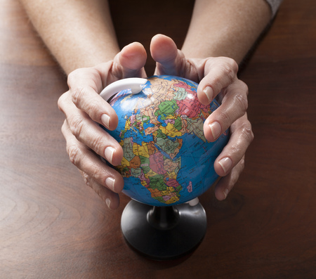 mother earth: womans hands holding globe for environment care and precious mother earth Stock Photo