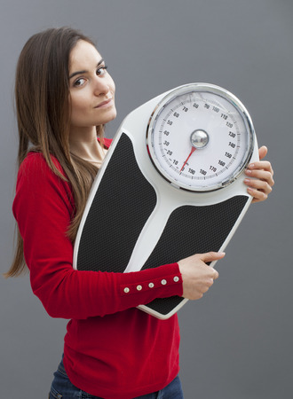 20s: smiling 20s woman taking care of her health with weight control