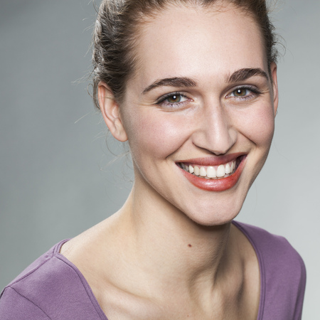 20s: closeup on radiant smiling 20s girl expressing happiness and wellbeing Stock Photo