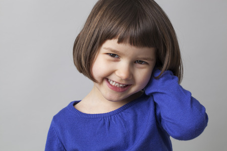 young happy preschool girl smiling in front of the camera for happiness 스톡 콘텐츠