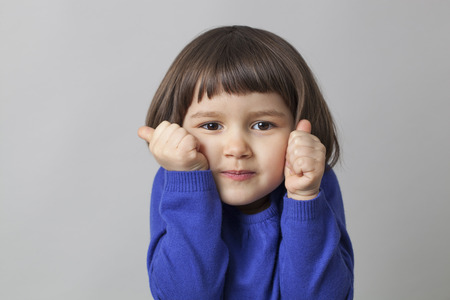 shyness: 3-year old preschool girl learning how to count on her fingers