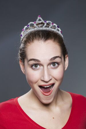 beauty contest: beautiful 20s girl excited and surprised of having won a beauty contest