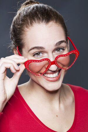 20s: gorgeous fun 20s woman with love glasses on her nose