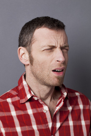 complain: closeup portrait of frowning 40s man wearing casual shirt disturbed and ready to complain Stock Photo