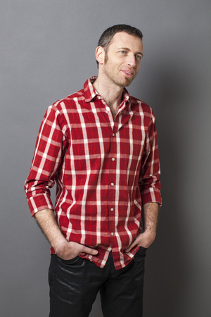 checked shirt: natural smile - relaxed smiling middle age man wearing casual red checked shirt with beard and goatee for comfort,studio shot
