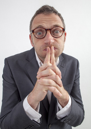 expressive corporate man concept - funny middle age businessman with eyeglasses puffing his cheeks from management doubt or leadership resignation,wide angle on white background