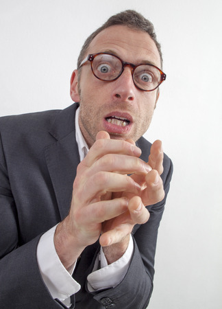 nervousness: expressive corporate man concept - stressed out middle age businessman with eyeglasses terrified by management phobia or entrepreneurship,wide angle on white background Stock Photo
