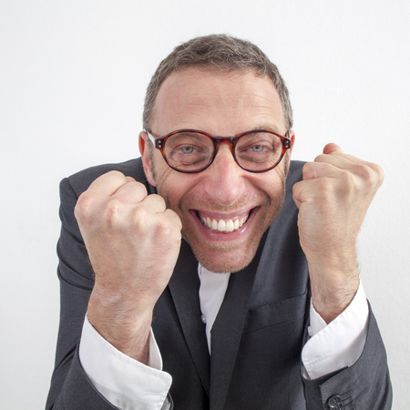 expressive corporate man concept - sneaky middle age businessman expressing success and energy with humor,wide angle on white background Stock Photo
