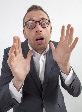 horrified: expressive corporate man concept - surprised 40s businessman with hand gesture horrified by phobia or entrepreneurship,wide angle on white background