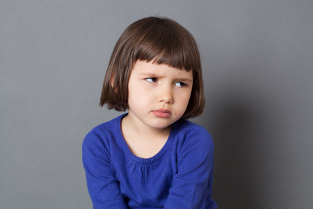 kid attitude concept - grumpy 4-year old child with bob cut sulking with dirty look for complain or disagreement,studio shot Foto de archivo