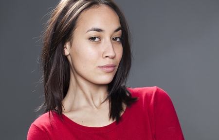 pretentious: pride and arrogance - sexy young multiethnic girl acting superior and proud for seduction and pretentiousness