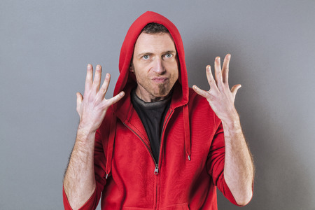 40s: hand gesture concept - angry 40s man expressing exasperation and impatience with nervous hands up,studio shot