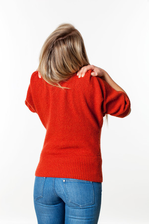 lumbago: backache, lumbago, scoliosis health problems - young blond woman relaxing her shoulders and neck with self-massage and acupressure,white background