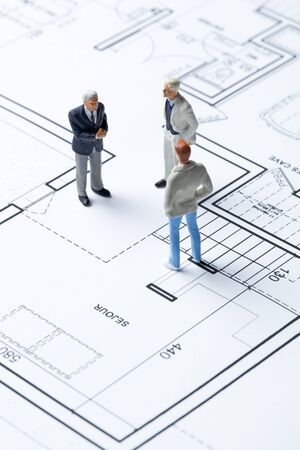 real business: minatures of professionals working on negotiation in architecture and housing market Stock Photo
