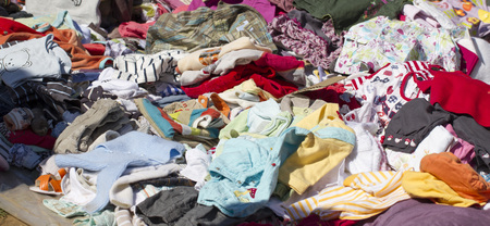 tons of baby clothes at flea market in the summer time