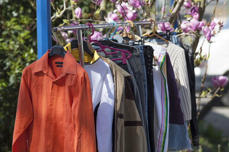 clothing: spring clothes display at garage sale in the summer Stock Photo